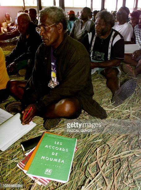 Members of the New Caledonian party Caledonian Union faction of the proindependence Kanak Socialist Liberation Front attend an electoral meeting 30...