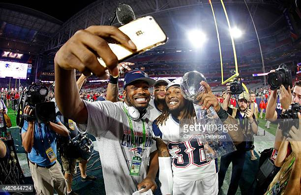 Members of the New England Patriots celebrate with the Vince Lombardi Trophy after defeating the Seattle Seahawks 2824 in Super Bowl XLIX at...