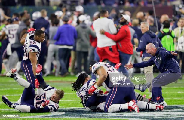 Members of the New England Patriots react after defeating the Atlanta Falcons 3428 to win Super Bowl 51 at NRG Stadium on February 5 2017 in Houston...