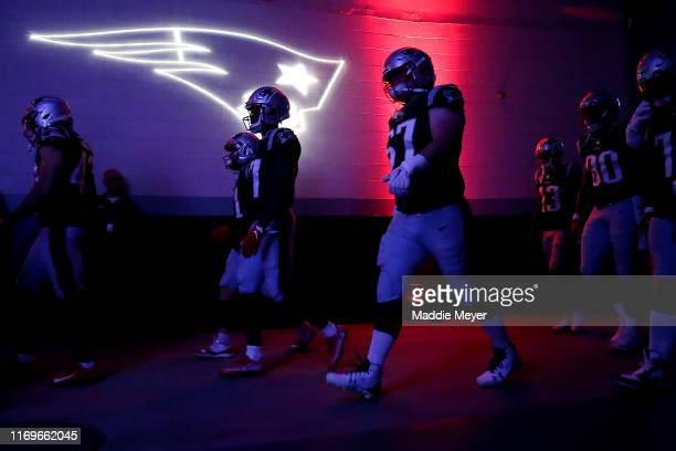 Members of the New England Patriots walk through the tunnel before the preseason game between the Carolina Panthers and the New England Patriots at...