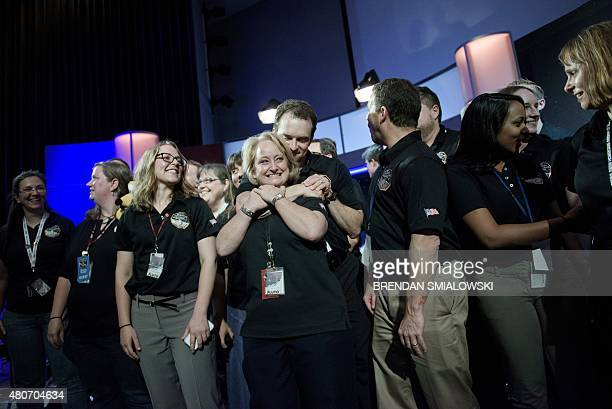 Members of the New Horizons mission team wait for a press conference at the Johns Hopkins University Applied Physics Laboratory July 14 2015 in...