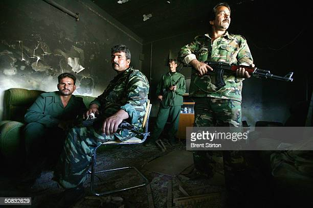 Members of the new Iraqi army pose while performing security checks on houses May 6 2004 in Fallujah Iraq Although not yet involved in active...