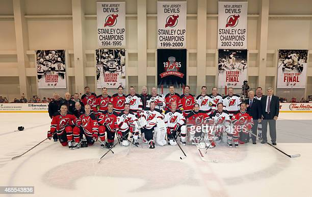 3d528df8a Members of the New Jersey Devils 1995 Stanley Cup Championship Team pose  for a photo during