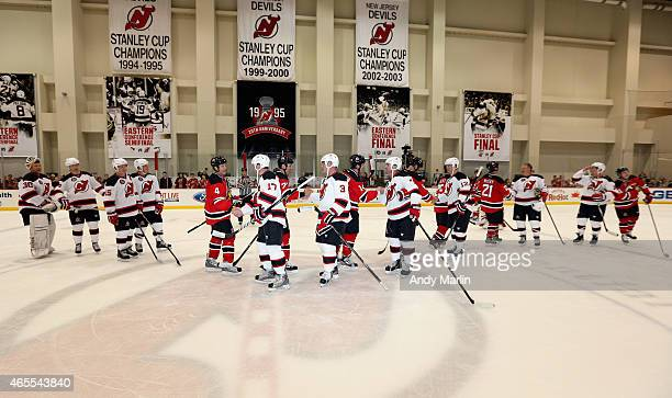 1e0e10b49 Members of the New Jersey Devils 1995 Stanley Cup Championship Team shake  hands at the conclusion