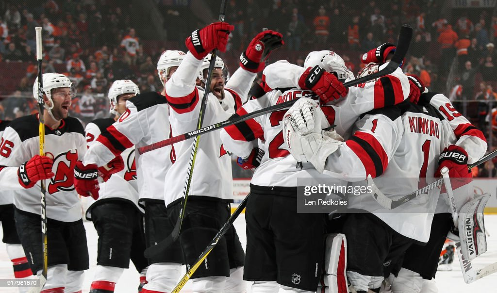 Members of the New Jersey Devils celebrate after defeating the Philadelphia Flyers 5-4 in a shootout on February 13, 2018 at the Wells Fargo Center in Philadelphia, Pennsylvania.