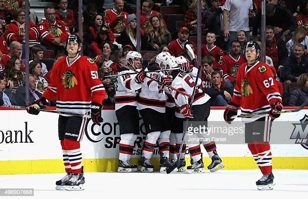 Members of the New Jersey Devils including Jacob Josefson, Travis Zajac and Sergey Kalinin of the New Jersey Devils celebrate Kalinin's game-winning...