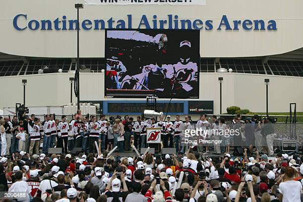 Members of the New Jersey Devils present the Stanley Cup as the Devils celebrate their Stanley Cup championship with their fans in the parking lot at...