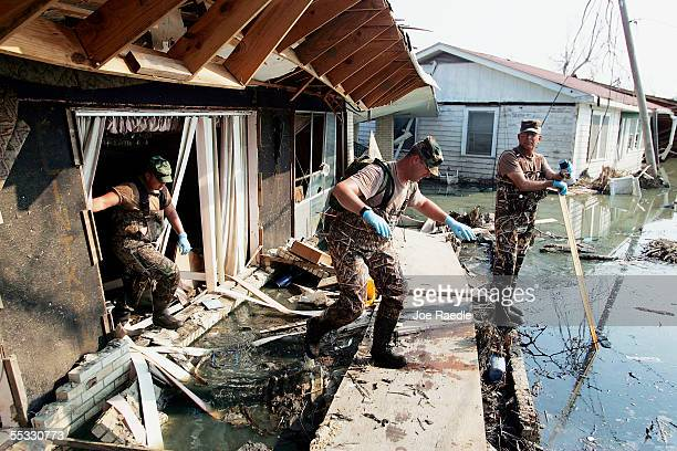 Members of the New Mexico National Guard checks for bodies in homes destroyed after Hurricane Katrina passed through September 10 2005 in Port...