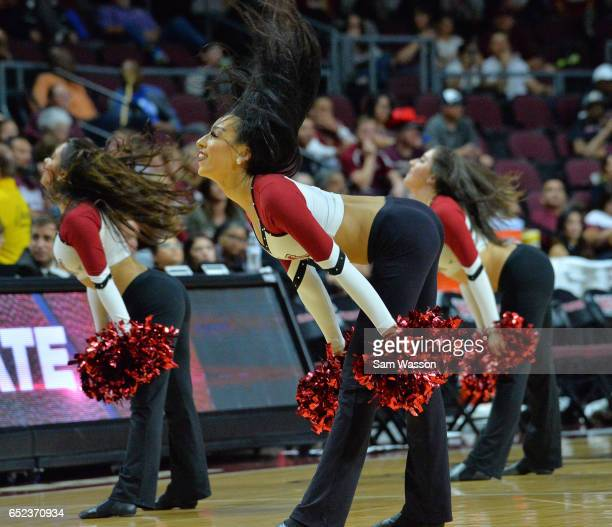 Members of the New Mexico State Aggies dance team perform during the championship game of the Western Athletic Conference Basketball tournament...