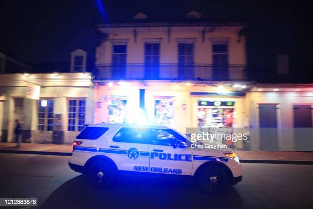 Members of the New Orelans Police Department help clear Bourbon Street as Louisiana Governor John Bel Edwards orders bars gyms and casinos to close...