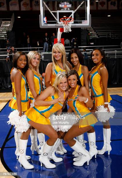 Members of the New Orleans Hornets dance team The Honeybees pose for a photograph on center court during NBA Jam Session Presented by Adidas on...
