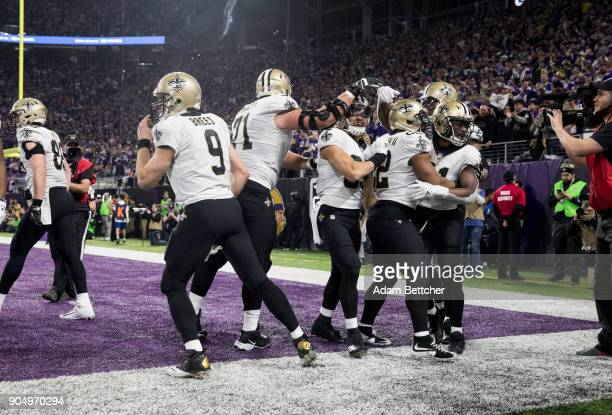 Members of the New Orleans Saints celebrate a gametying touchdown from quarterback Drew Brees to Alvin Kamara in the fourth quarter of the NFC...