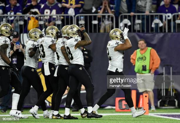 Members of the New Orleans Saints celebrate after intercepting the ball in the third quarter of the NFC Divisional Playoff game against the Minnesota...