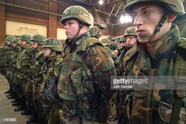 Members of the New York Army National Guard 105th Military Police Company stand ready to ship out for duty in the Persian Gulf region February 14...