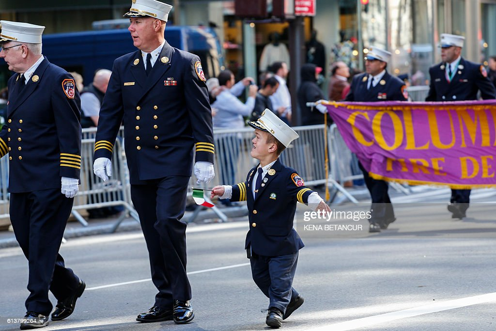 Members of the New York City fire department attend a march during the annual Columbus Day parade in New York on October 10, 2016. Columbus Day is a national holiday in many countries in the Americas and elsewhere which officially celebrates the anniversary of Christopher Columbus' arrival in the Americas on October 12, 1492. Many Italian-Americans observe Columbus Day as a celebration of their heritage, the first occasion being in New York City on October 12, 1866 / AFP / KENA