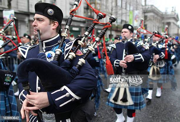 Members of the New York City Fire department play the bagpipes on the parade route during St Patrick's Day festivities in Dublin on March 17 2013...
