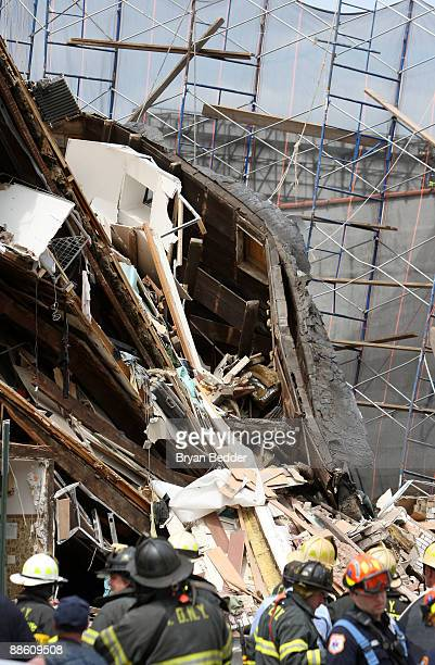 Members of the New York City Fire Department survey the scene of a collapsed a four-story building June 21, 2009 in the Fort Greene neighborhood of...