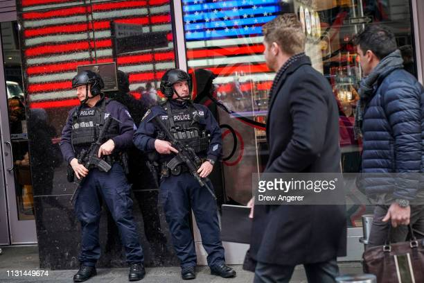 Members of the New York City Police Counterterrorism unit patrol stand watch in Times Square March 18 2019 in New York City After a gunman killed...