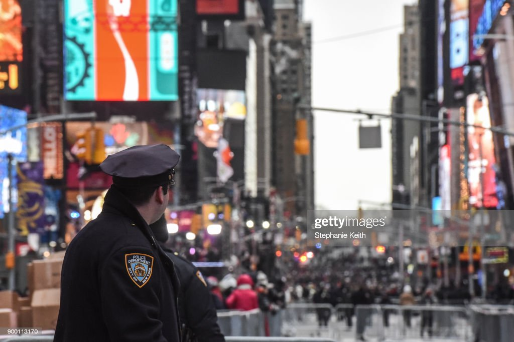Members of the New York City police department patrol in Times Square ahead of the New Year's Eve celebration on December 31, 2017 in New York City.