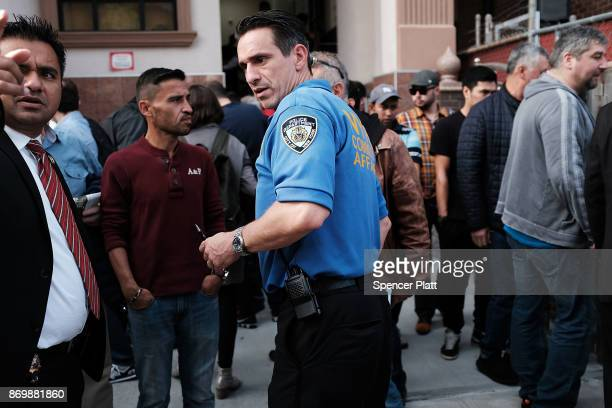 Members of the New York City Police Department speak with worshippers after Friday Prayer at the Eyup Cultural Center mosque which has a large number...