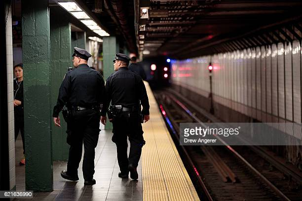 Members of the New York City Police patrol a subway station in Times Square November 7 2016 in New York City With both presidential candidates...