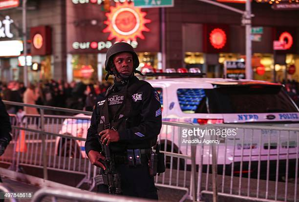 Members of the New York City Police Strategic Response Group stand guard in New York's Times Square on November 18 2015