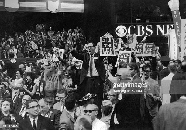 1968 Members of the New York delegation protesting against the Vietnam War during the Democratic National Convention held at Chicago Illinois They...