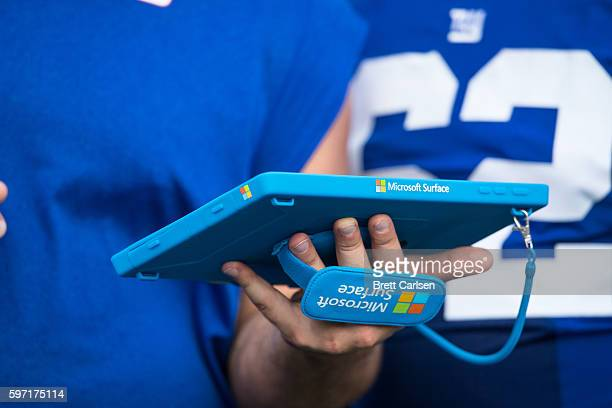Members of the New York Giants go over game plans on a Microsoft Surface tablet during the game against the Buffalo Bills on August 20 2016 at New...