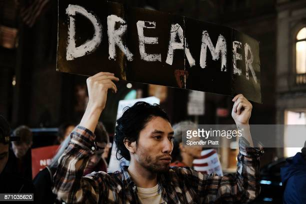 Members of the New York Immigration Coalition recent immigrants and activists rally outside of Trump Tower to announce 'Dream for Our New York' which...