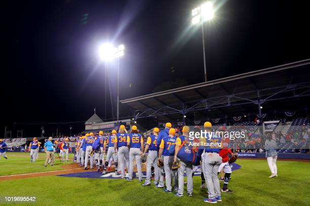 Members of the New York Mets and the Philadelphia Phillies shake hands after the 2018 Little League Classic at Historic Bowman Field on Sunday August...