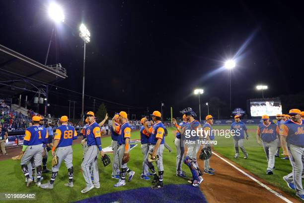 Members of the New York Mets celebrate after defeating the Philadelphia Phillies in the 2018 Little League Classic at Historic Bowman Field on Sunday...