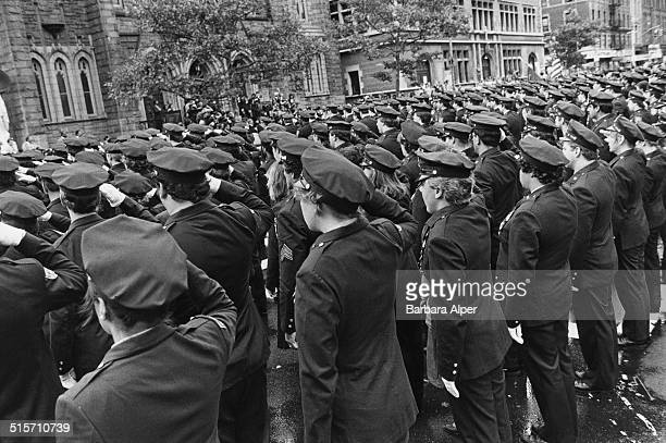 Members of the New York Police Department attend athe funeral of a fellow offcer New York City 1987