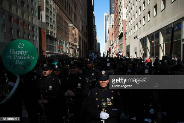 Members of the New York Police Department band wait to march during the annual St Patrick's Day parade on 5th Avenue March 17 2017 in New York City...