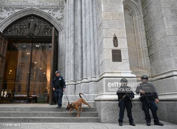 Members of the New York Police Department gather outside St Patrick's Cathedral on 5th Avenue April 18 the morning after a man was arrested after...