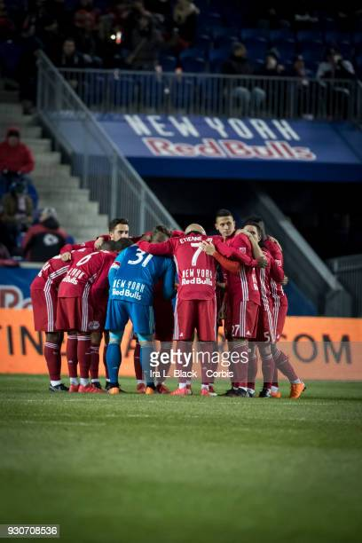 Members of the New York Red Bulls huddle before the second half during the MLS match between New York Red Bulls and Portland Timbers at Red Bull...