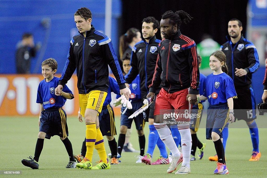 Members of the New York RedBulls and Montreal Impact take to the pitch prior to facing each other in their MLS game at the Olympic Stadium on April 5, 2014 in Montreal, Quebec, Canada.