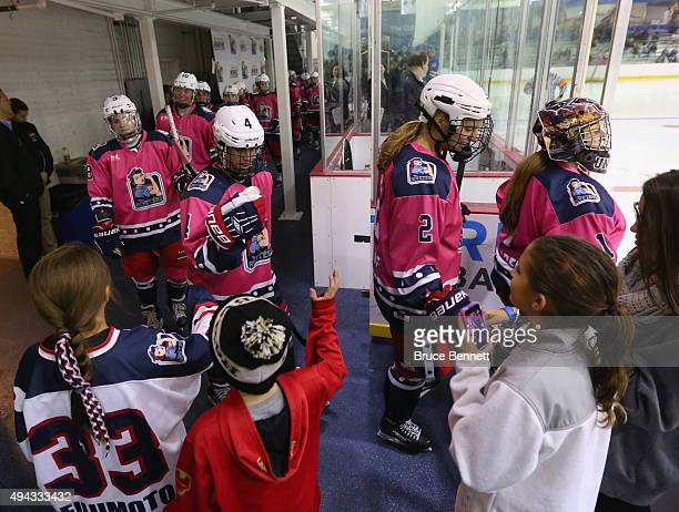 Members of the New York Riveters of the National Womens Hockey League highfive fans while walking out for the third period against the Connecticut...