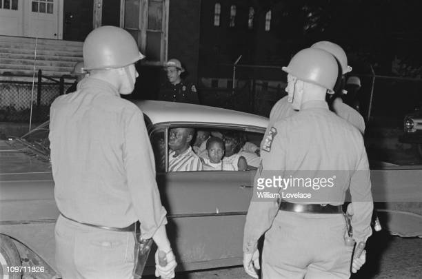 Members of the New York State Police on duty during a race riot in Rochester, New York State, late July 1964.