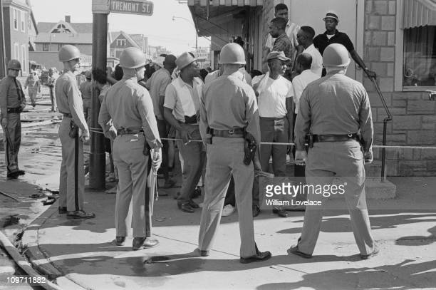 Members of the New York State Police on Tremont Street during a race riot in Rochester New York State late July 1964