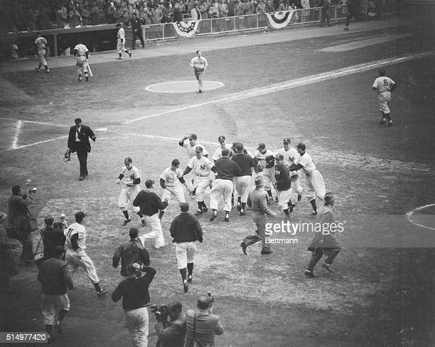 Members of the New York Yankee Team from a happy group on the field at Yankee Stadium today after Bauer caught Giant Yvars' fly to right field to end...