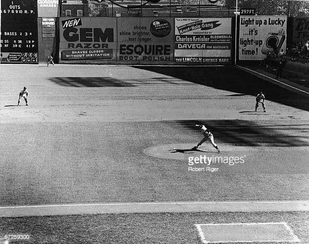 Members of the New York Yankees American professional baseball team man their fielding positions against the Brooklyn Dodgers during a World Series...