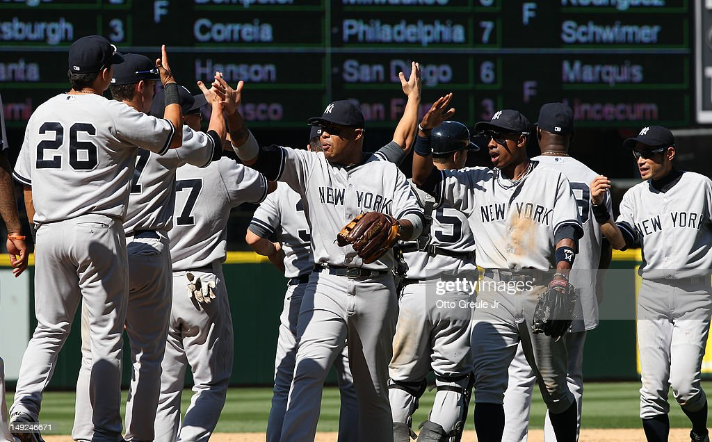 Members of the New York Yankees celebrate after defeating the Seattle Mariners 5-2 at Safeco Field on July 25, 2012 in Seattle, Washington.