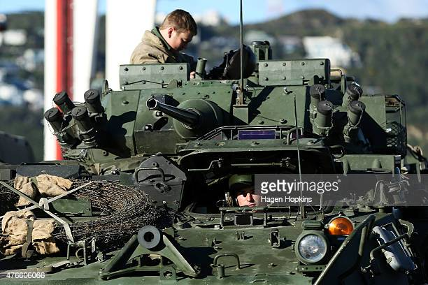 Members of the New Zealand Defense Force looks on from a Light Armoured Vehicle prior to being loaded into the HMNZS Canterbury at Aoeta Wharf on...