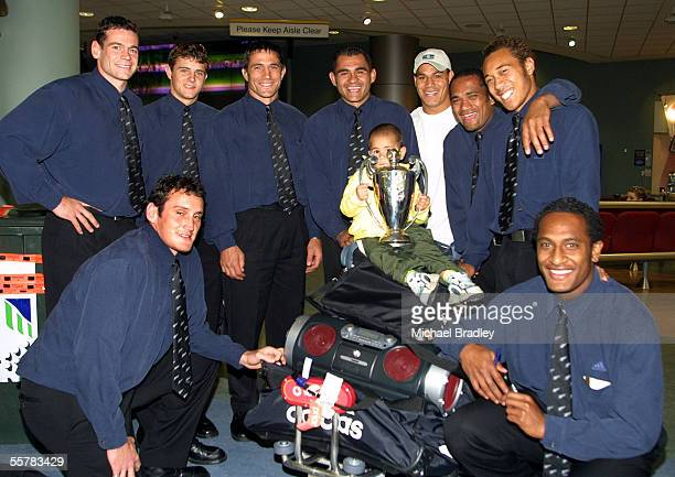 Members of the New Zealand Sevens team Craig De Goldi Nick Evans Dallas Seymour and captain Eric Rush with Rush's son Brady Chris Masoe Amasio...