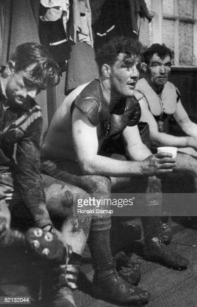 Members of the New Zealand team relax in their changing room after a match against Lancashire at Harrington Oval December 1951 Original Publication...