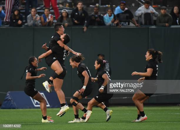 Members of the New Zealand women's rugby team celebrate after winning the Championships Final against France at the Rugby Sevens World Cup in the...