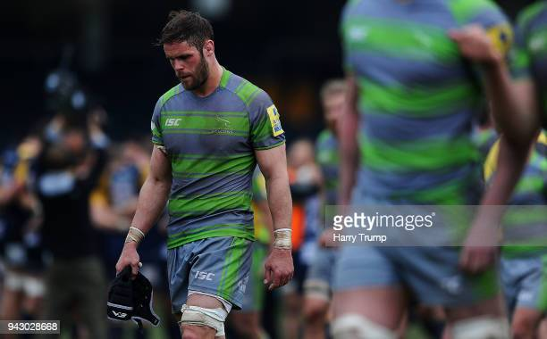 Members of the Newcastle Falcons side cut dejected figures at the final whistle during the Aviva Premiership match between Worcester Warriors and...