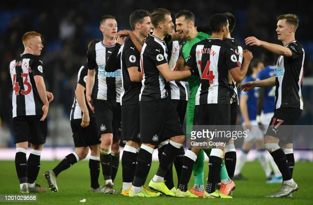 Members of the Newcastle side celebrate after the Premier League match between Everton FC and Newcastle United at Goodison Park on January 21 2020 in...