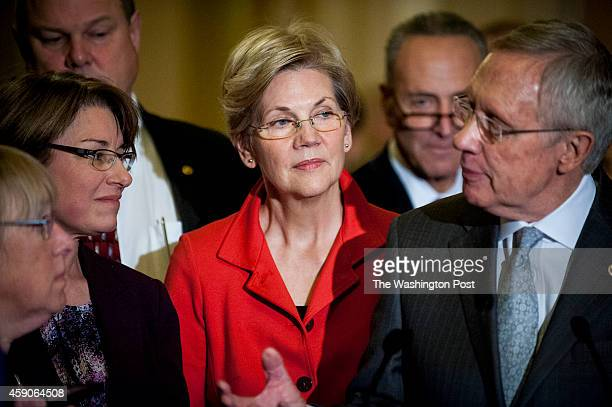 Members of the newly elected Democratic Senate Leadership, Senators Amy Klobuchar and Elizabeth Warren look on as Senate Majority Leader Harry Reid...