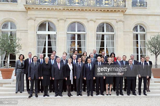 Members of the newly reshuffled French government pose for a family picture, on November 17, 2010 in the courtyard of the Elysee Palace in Paris...